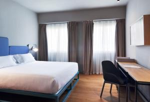 A bed or beds in a room at One Shot Colón 46