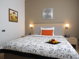 Krevet ili kreveti u jedinici u okviru objekta IN Hotel Beograd