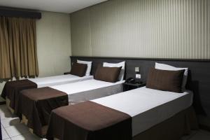 Cama ou camas em um quarto em Hotel Extasy (Adult Only)