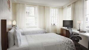 A bed or beds in a room at Renaissance New Orleans Pere Marquette French Quarter Area Hotel