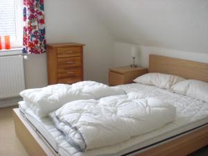 Ein Bett oder Betten in einem Zimmer der Unterkunft Ferienhaus in Bartelshagen II
