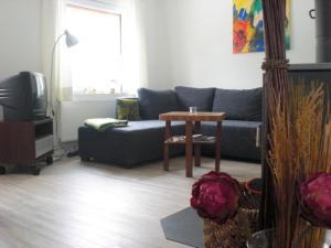 Ein Sitzbereich in der Unterkunft Ferienhaus in Bartelshagen II