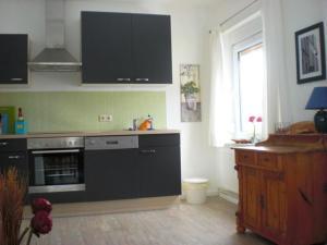 Küche/Küchenzeile in der Unterkunft Ferienhaus in Bartelshagen II