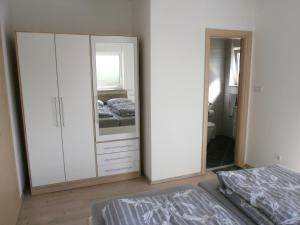 A bed or beds in a room at Apartments Bora