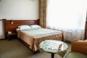 Кровать или кровати в номере Визит