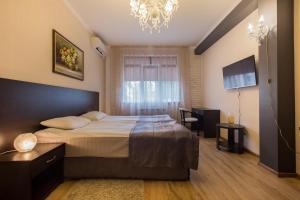 Кровать или кровати в номере Apartamenty na Moskovskoy