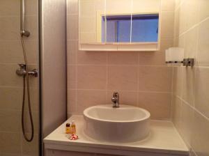 Ein Badezimmer in der Unterkunft Thüringer Hof
