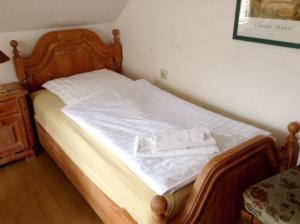Ein Bett oder Betten in einem Zimmer der Unterkunft Thüringer Hof