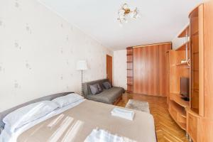 A bed or beds in a room at Apartment in Yugo-Zapadnaya