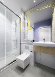 A bathroom at ibis Styles Glasgow Centre George Square