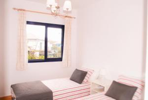Cama o camas de una habitación en Bahia Meloneras