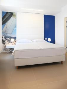 A bed or beds in a room at Guesthouse Villa Scalaria