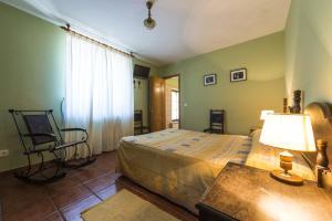Cama o camas de una habitación en Hotel Rural Valle de Ancares