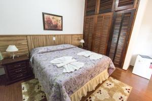 Cama ou camas em um quarto em Pousada Villa Romana