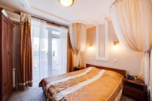 Кровать или кровати в номере Апартаменты Херсонес