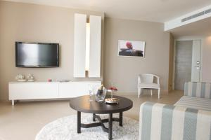 A television and/or entertainment center at Ramada Hotel & Suites by Wyndham Netanya