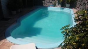 A view of the pool at Hotel Coimbra or nearby