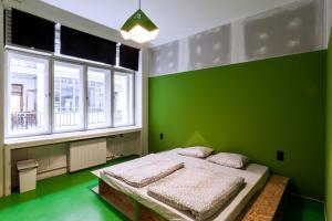 A bed or beds in a room at Essential Hostel