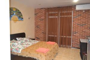 Кровать или кровати в номере Dachnyi Domik