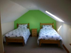A bed or beds in a room at Clonmacnoise B&B