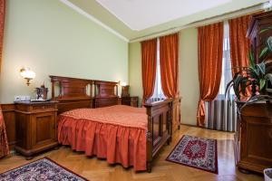 Postel nebo postele na pokoji v ubytování Hotel Jelínkova vila