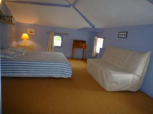 Un ou plusieurs lits dans un hébergement de l'établissement Au Bon Accueil