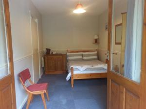 A bed or beds in a room at The Falcon Inn Retreat