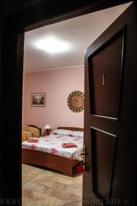 A bed or beds in a room at B&B Cuscino & Cappuccino