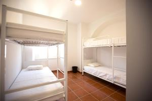 A bunk bed or bunk beds in a room at HI Évora – Pousada de Juventude
