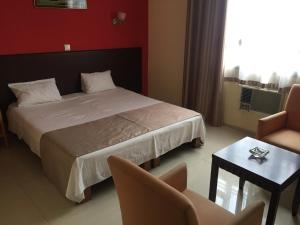 A bed or beds in a room at White Palace Hotel