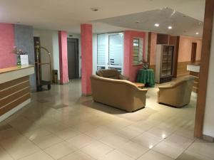 The lobby or reception area at White Palace Hotel