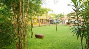 A garden outside Inlak Garden Hotel