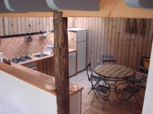 A kitchen or kitchenette at Domaine Le Rolant