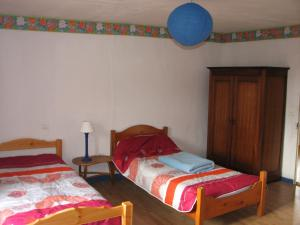 A bed or beds in a room at Tavaud