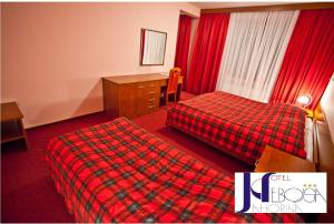 A bed or beds in a room at Hotel Nebojša Jahorina