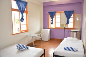 A bed or beds in a room at Caravella Central