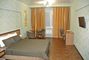 A bed or beds in a room at Boutik Hotel Surgut