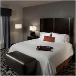 A bed or beds in a room at Hampton Inn and Suites Marksville