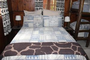 A bed or beds in a room at Old Vic Travellers Inn Nelspruit