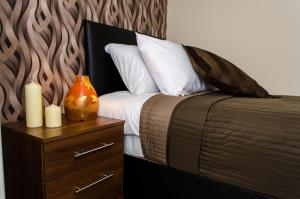 A bed or beds in a room at Trivelles Hotel - Manchester - Eccles New Road