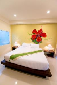 A bed or beds in a room at Maryo Resort