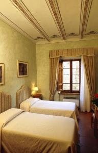 A bed or beds in a room at B&B Palazzo Al Torrione 2