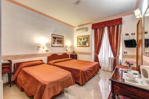 Letto o letti in una camera di Hotel Giuliana