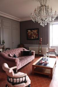 Coin salon dans l'établissement Le Rézinet - Chambres d'Hôtes