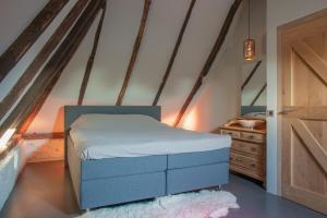 Een bed of bedden in een kamer bij Logies Groot Okhorst