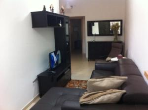 A television and/or entertainment centre at Genista Apartment