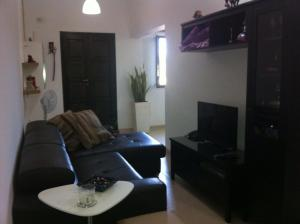 A seating area at Genista Apartment