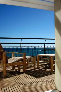 A balcony or terrace at Hotel Napoléon