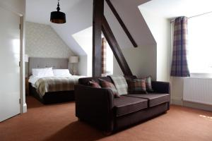 A bed or beds in a room at The Richard Onslow