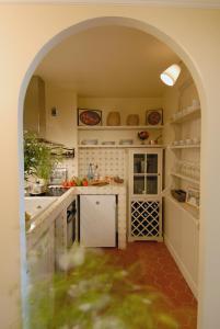 Cuisine ou kitchenette dans l'établissement La Maison Saint Germain